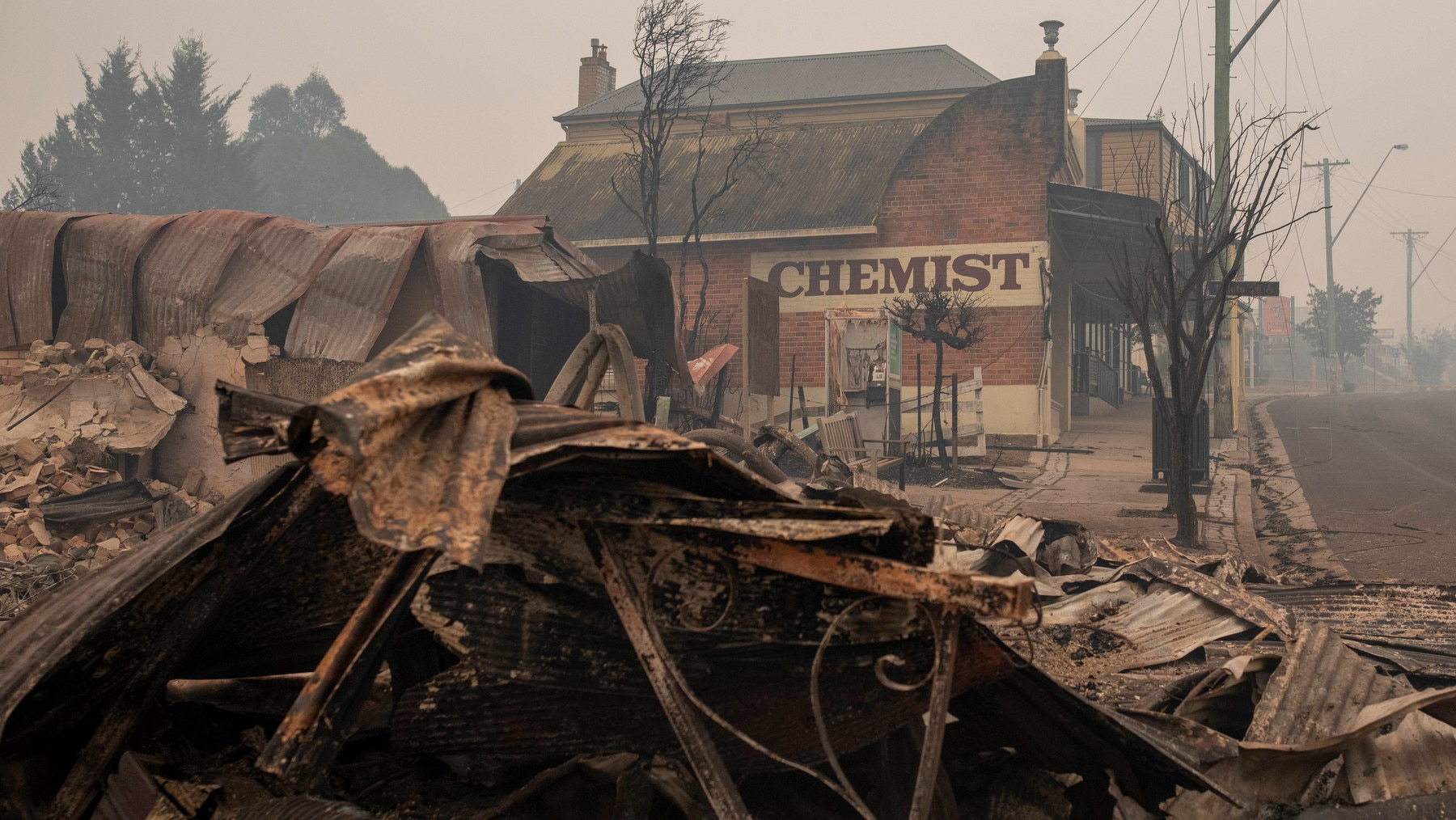 Destroyed buildings are seen in Cobargo, NSW, Wednesday, January 1, 2020. Several bushfire-ravaged communities in NSW have greeted the new year under immediate threat. (AAP Image/Sean Davey) NO ARCHIVING