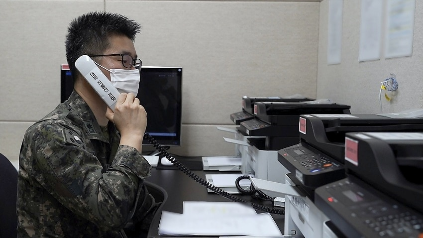 A South Korean military officer makes a test call with a North Korean officer on 4 October 2021.
