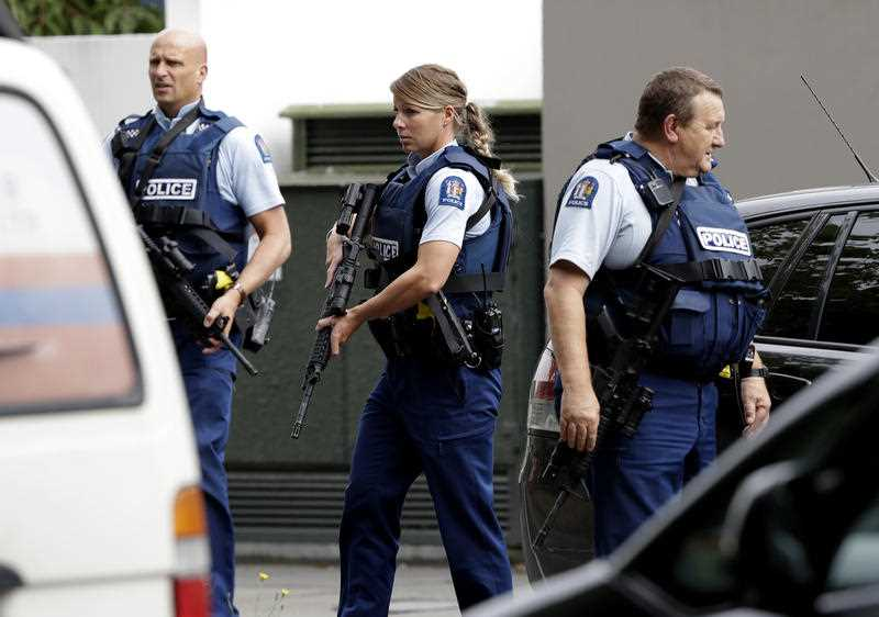 Armed police patrol outside a mosque in central Christchurch.