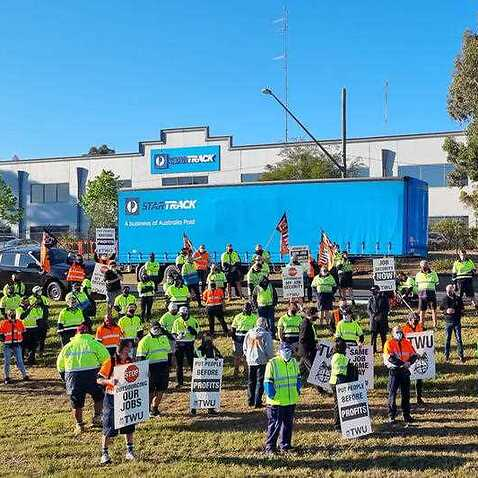 A supplied image obtained on Thursday, September 23, 2021, of StarTrack workers on strike in Sydney after crisis talks failed. Parcel deliveries across the country are being affected by a strike by up to 2000 StarTrack couriers who are in a dispute over p
