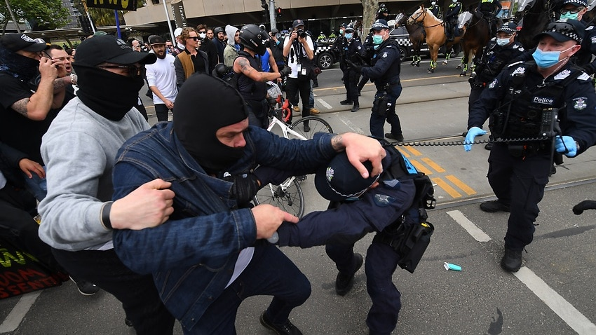 Police use pepper spray arrest 16 people as scuffles erupt at Melbourne anti-lockdown rally – SBS News