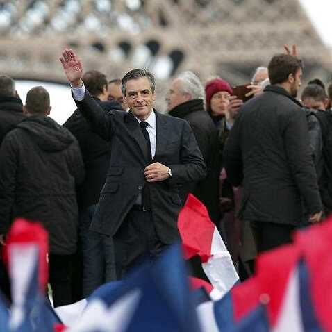 French conservative presidential candidate Francois Fillon waves after delivering his speech during a rally in Paris, Sunday, March 5, 2017.