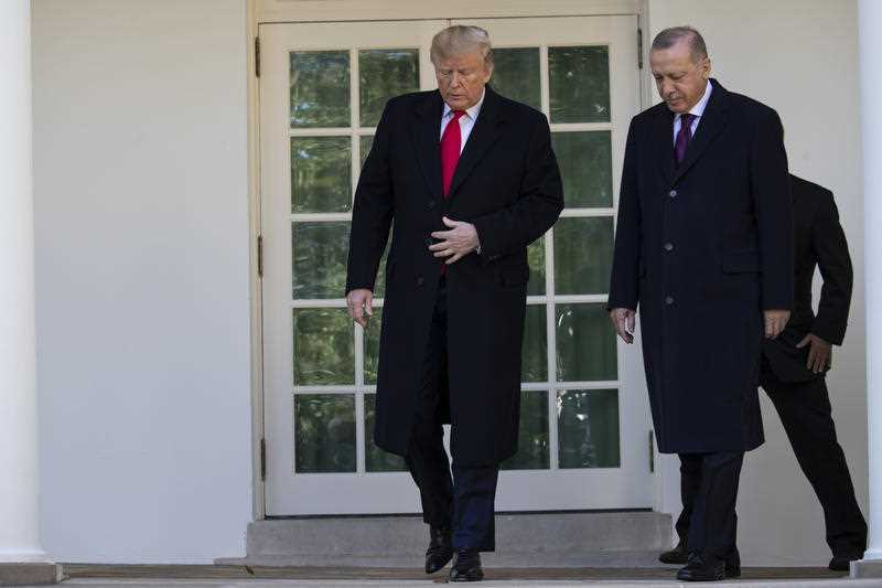 US President Donald Trump walks with Turkish President Recep Tayyip Erdogan to a meeting in the Oval Office