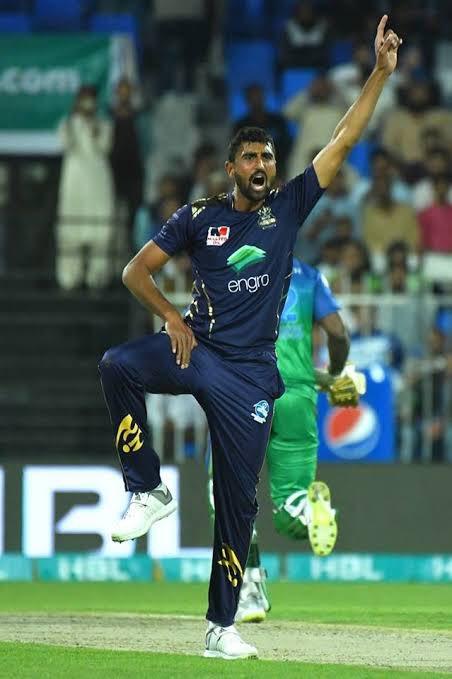 Mohammad Irfan Jr celebrating after taking a wicket in Pakistan Super League cricket tournament.