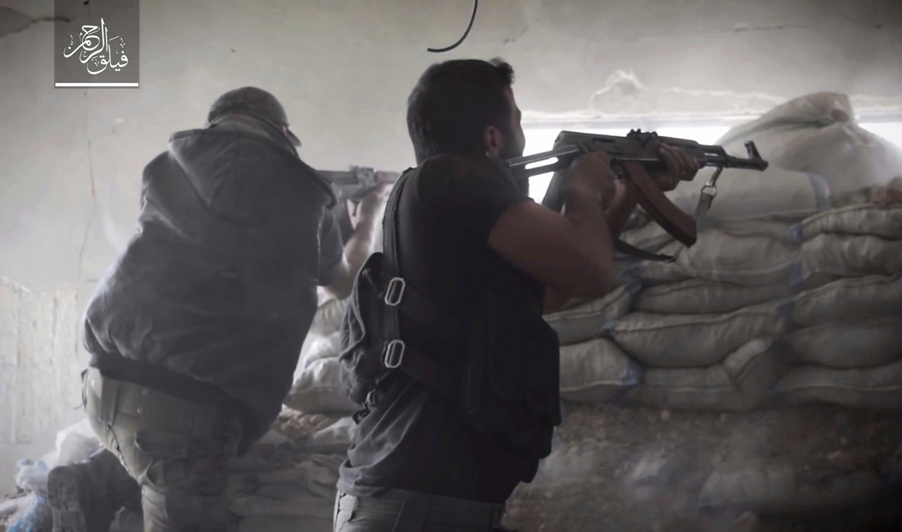 Rebel fighters with Failaq al-Rahman during clashes with government forces in the suburbs of the Syrian capital Damascus.