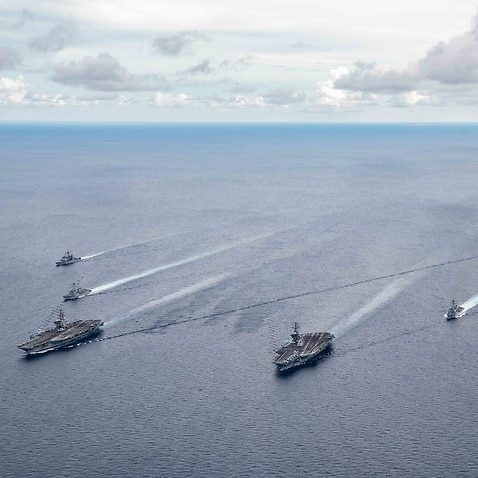 US ships taking part in a drill in the South China Sea on 6 July 2020.