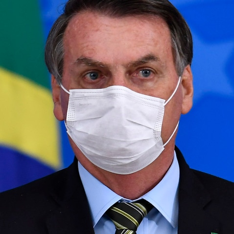 Brazil's President Jair Bolsonaro and Attorney General of the Republic Augusto Aras wearing protective masks.