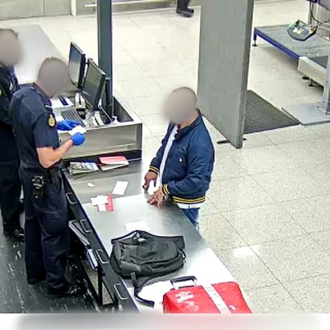 The Brazilian man being questioned by ABF officers at Perth Airport