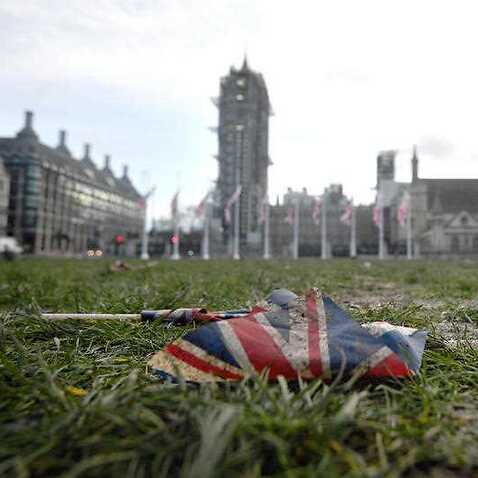 Union flags left discarded on the mud and grass at Parliament Square in London, following Brexit celebrations.