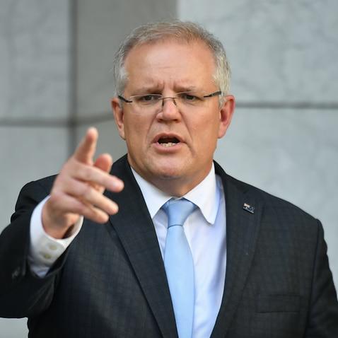 Prime Minister Scott Morrison talks to reporters.