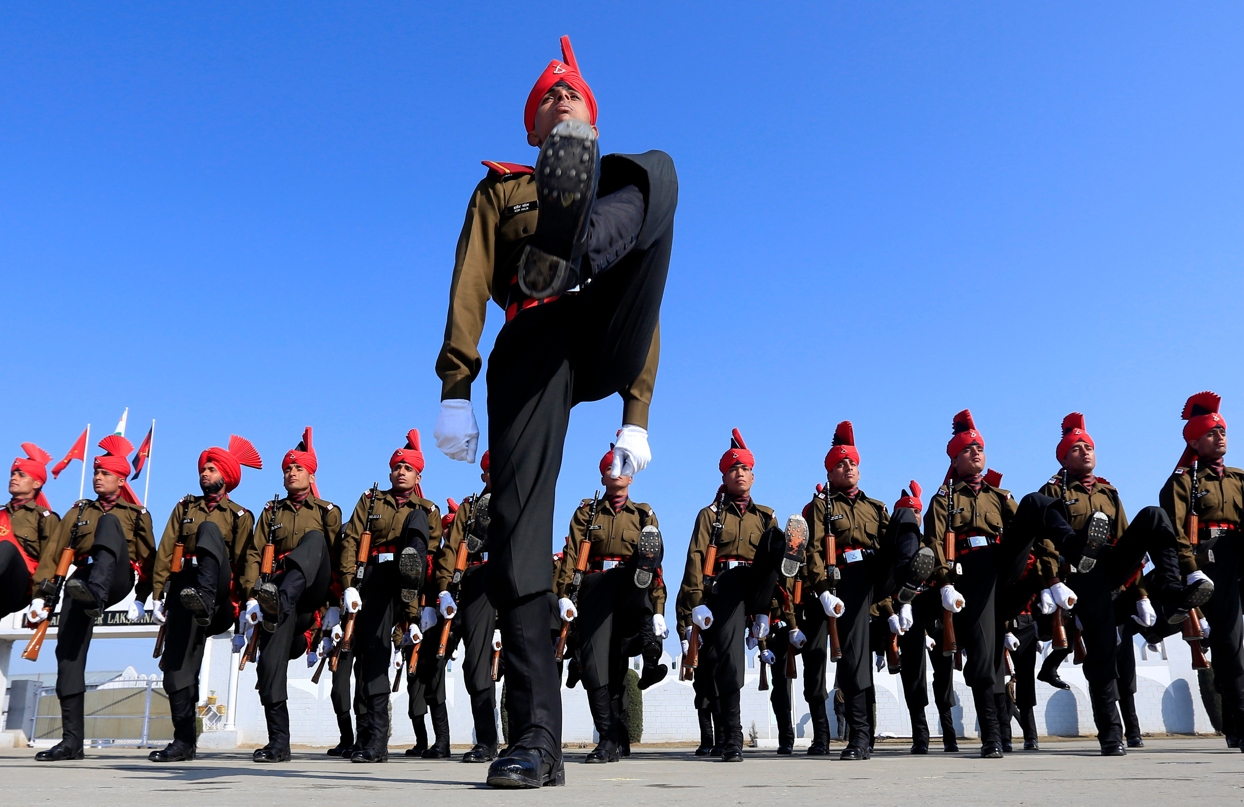 Soldiers of the Jammu and Kashmir Light Infantry march during their commencement parade at a military base on the outskirts of Srinagar, India, Saturday, 2014.