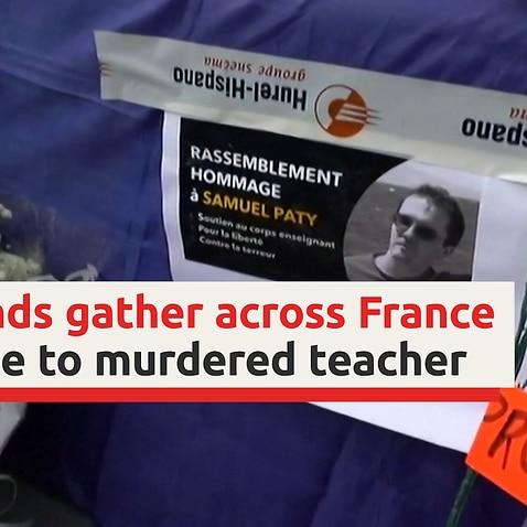 Demonstrators pay tribute to slain teacher across France