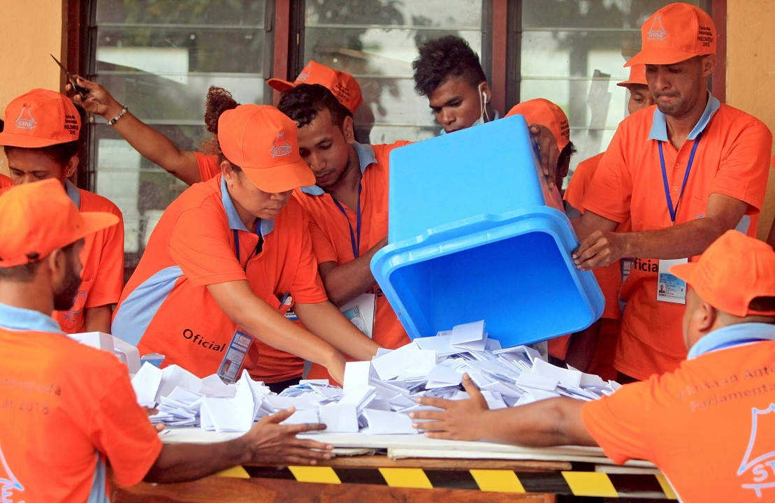 Timor Leste workers count votes during the parliamentary election.