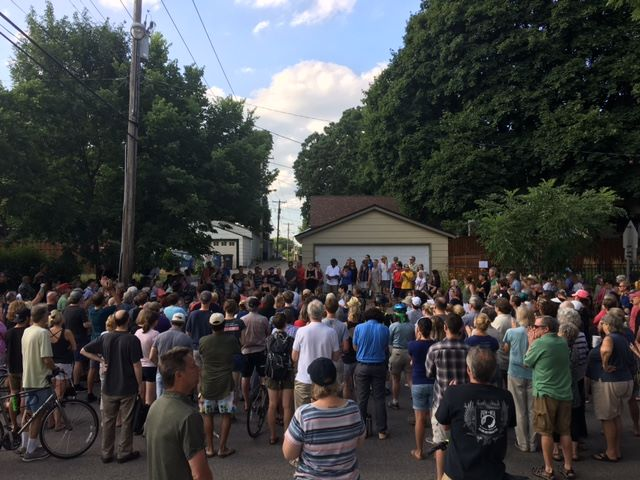 A vigil for Ms Damond attracted hundreds of people.