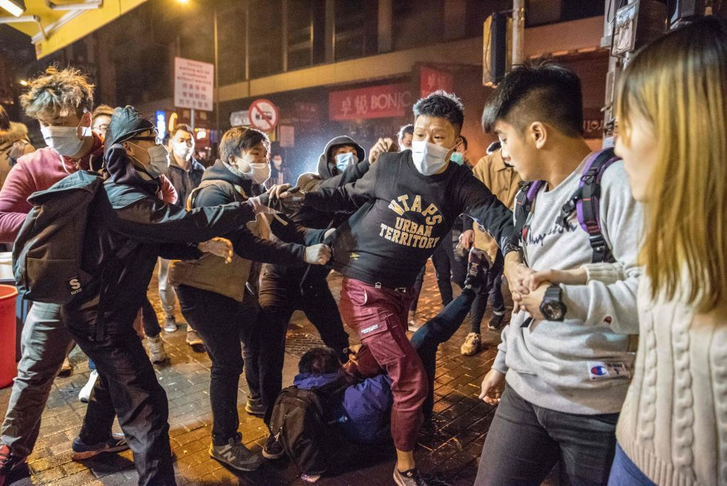 An altercation takes place during clashes between protesters and police in 2016.