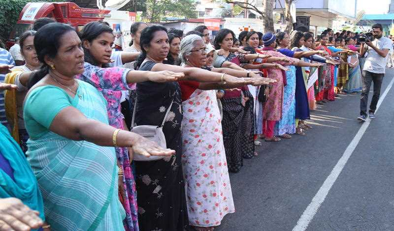 Indian women rise their hands as they pledge to protect the renaissance values and gender equality while participating in the 'Women's Wall' in Kochi, India.