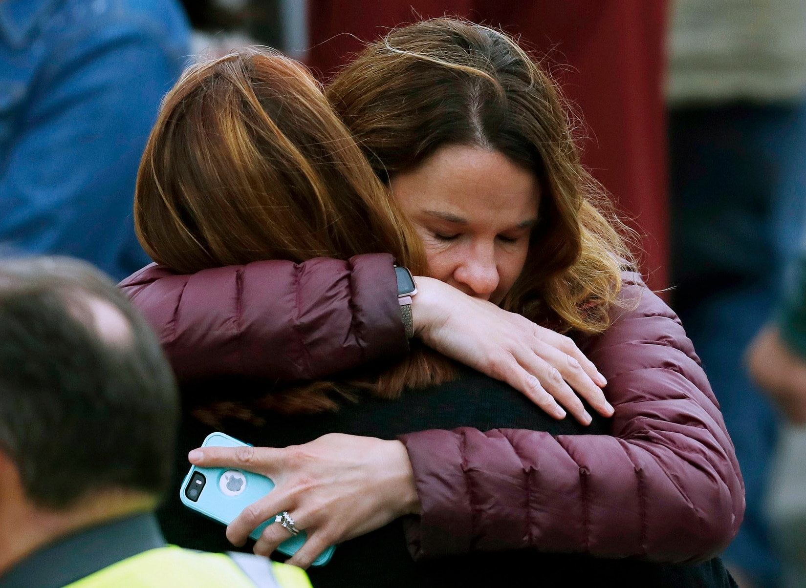 Parents hug as they wait for their children after a shooting at a suburban Denver school.
