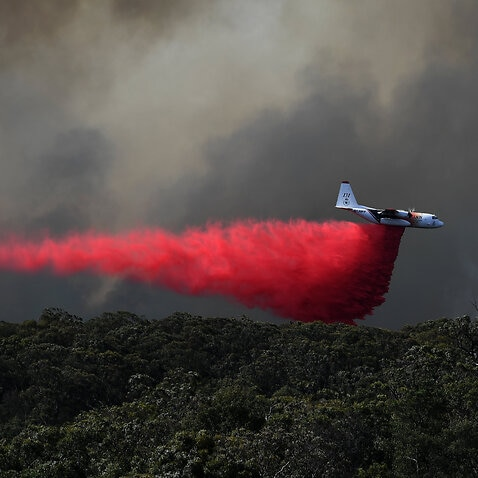 An air tanker drops fire retardant on the Gospers Mountain fire near Colo Heights south west of Sydney.