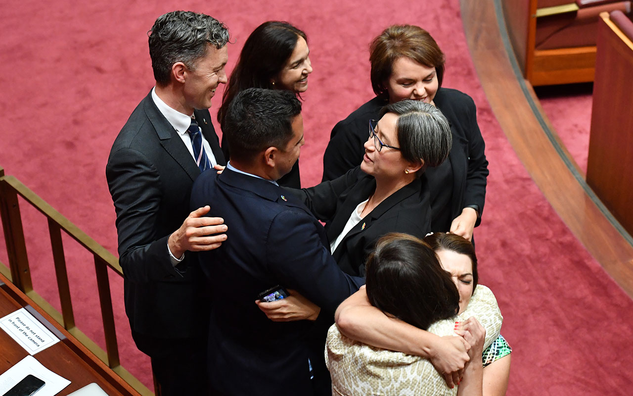 Shadow Minister for Foreign Affairs Penny Wong and fellow marriage equality supporters after the vote.