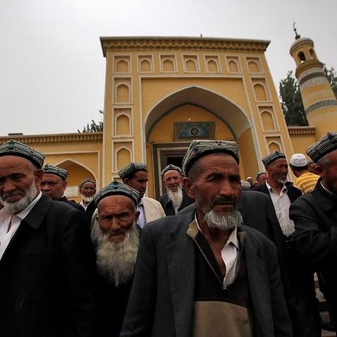 Uighur men leave a mosque in Kashgar, Xinjiang Uighur Autonomous Region, China, in 2013.