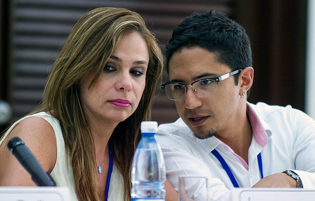Colombian victim of the armed conflict Angela Maria Giraldo and Jose Antequera during a press conference on August 16, 2014, in Havana. FARC