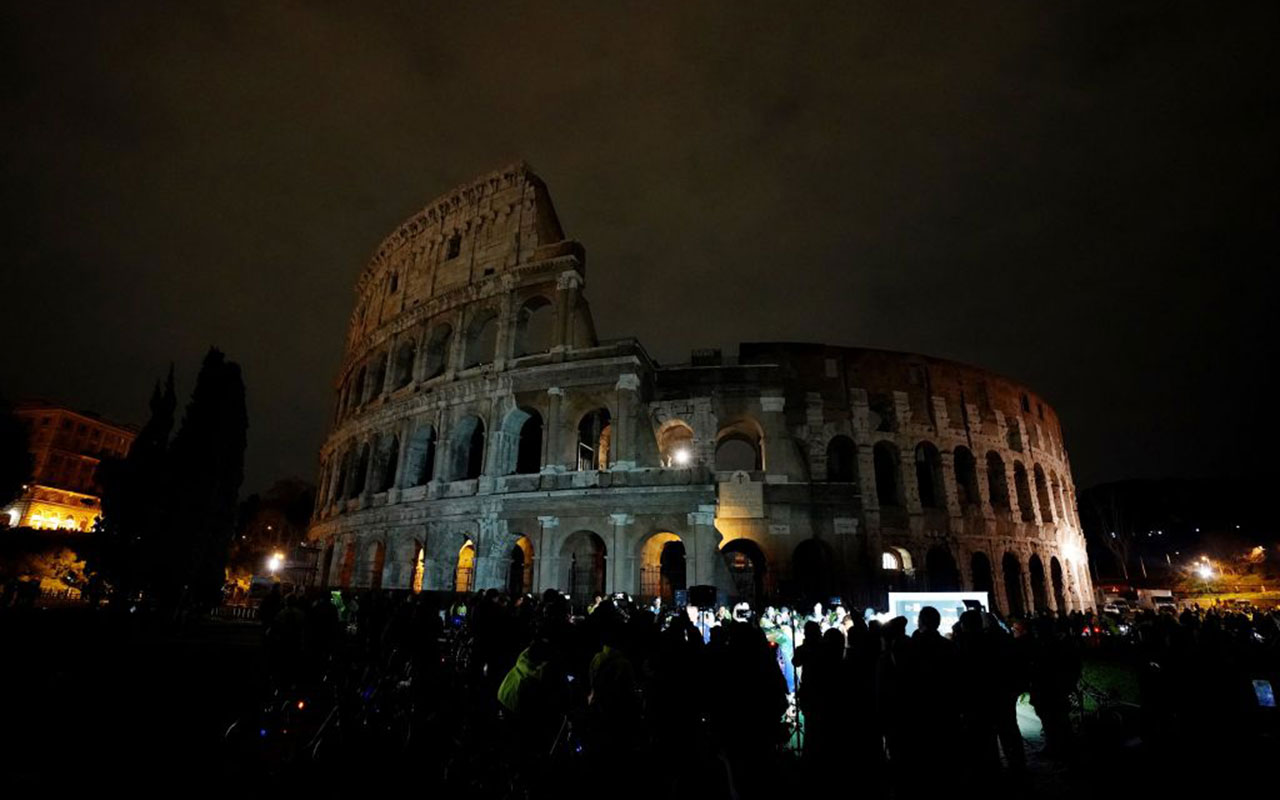 The ancient Colosseum in the dark during the Earth Hour.
