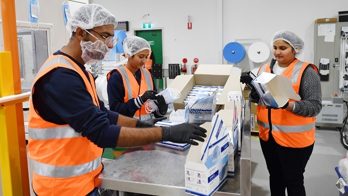 Employees on the production line of the Detmold PPE production facility in Brompton, Adelaide.