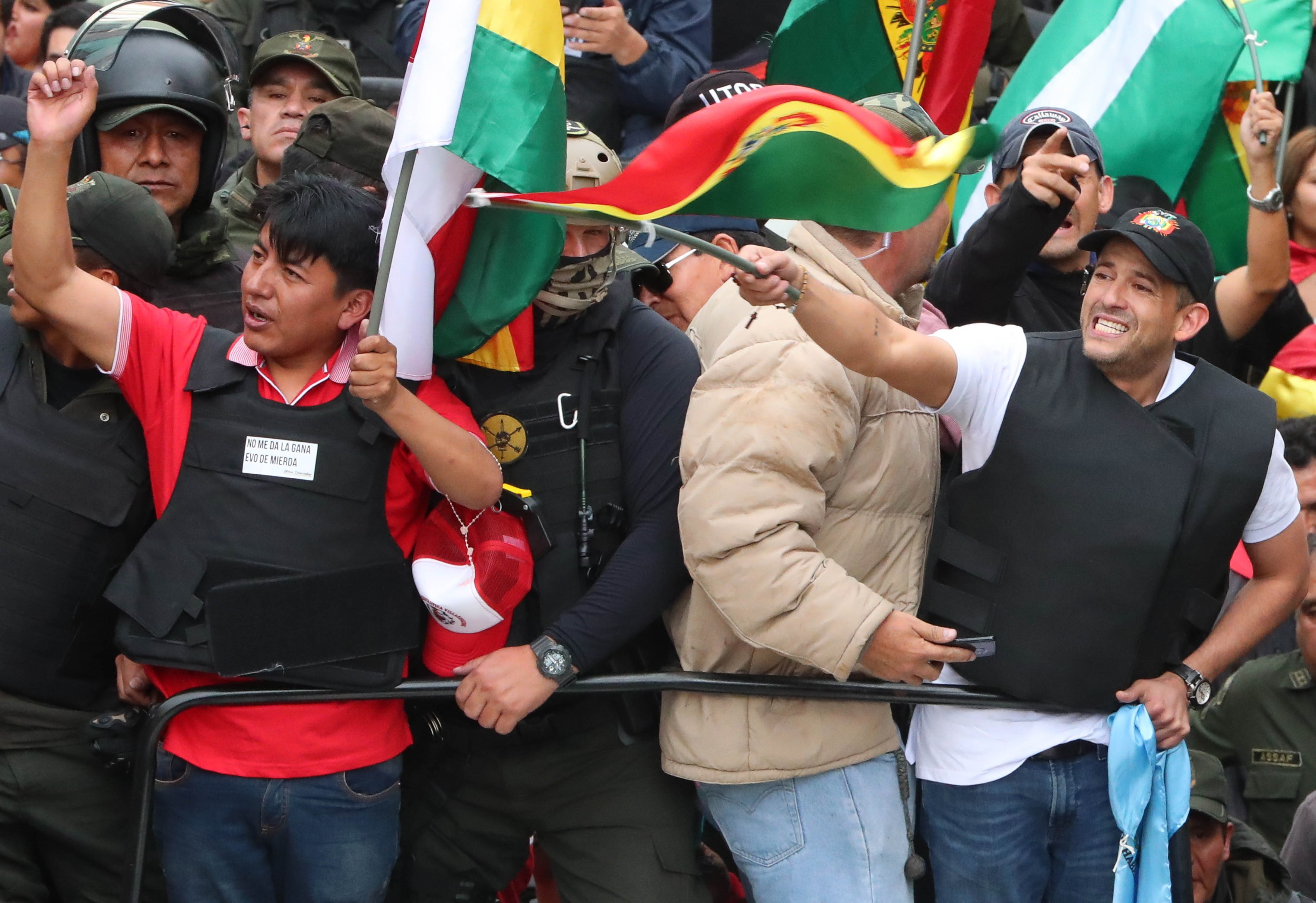 Civic leaders Luis Fernando Camacho (R) and Marco Pumari (L) celebrate with Bolivians the resignation of President Evo Morales