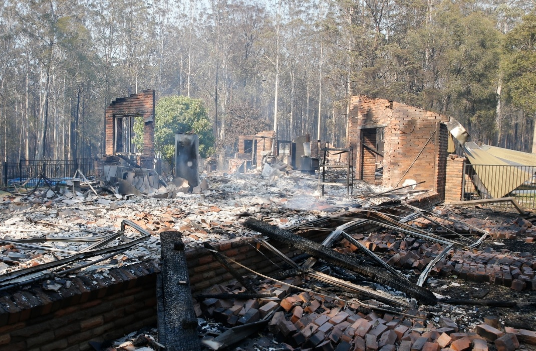 Australia orders evacuations as firefighters struggle to contain bushfires