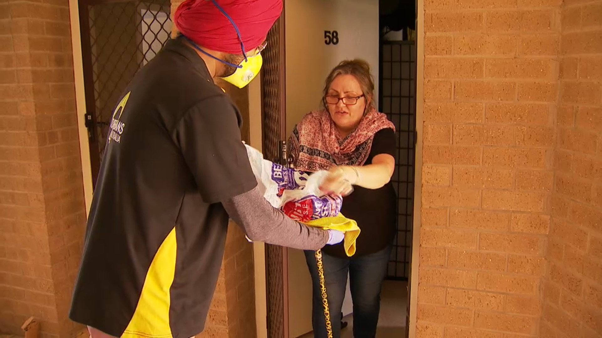 Marilouise receives her meal from Turbans 4 Australia.