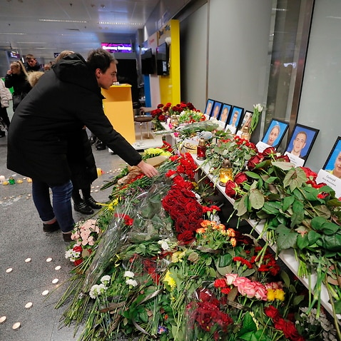Relatives and friends of crew members of the Ukraine International Airlines Flight PS752 lay flowers and light candles at Boryspil International Airport, Kiev.