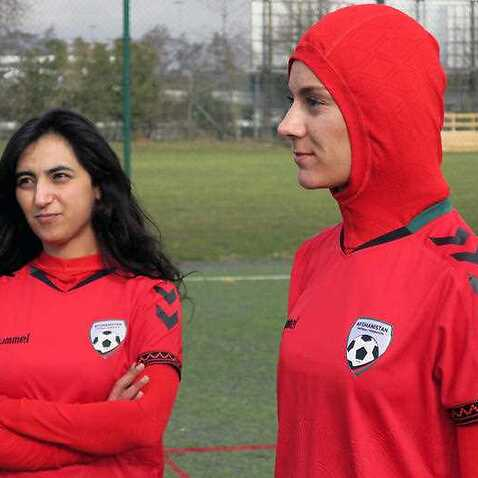 Afghani national soccer player Shabnam Mabarz, right, wearing the new head-to-toe outfit with an integrated hijab, stands next to Khalida Popal.