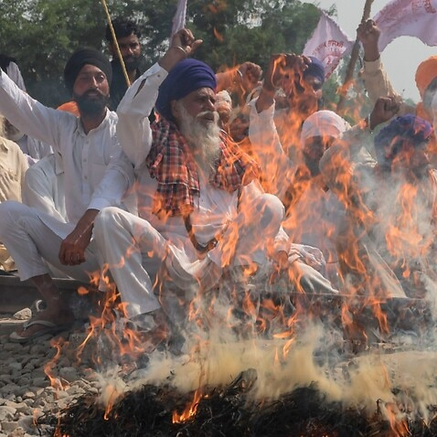What has sparked the massive farmers protest in India amidst the coronavirus pandemic?