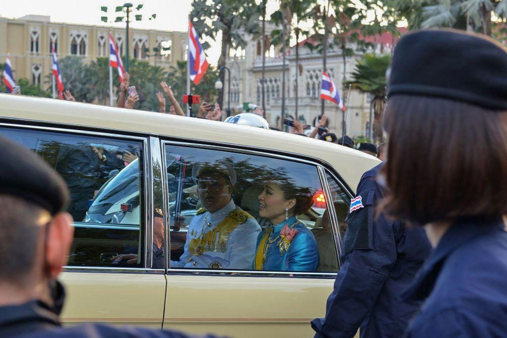 Thailand's Queen Suthida (C) and Prince Dipangkorn Rasmijoti (centre L)