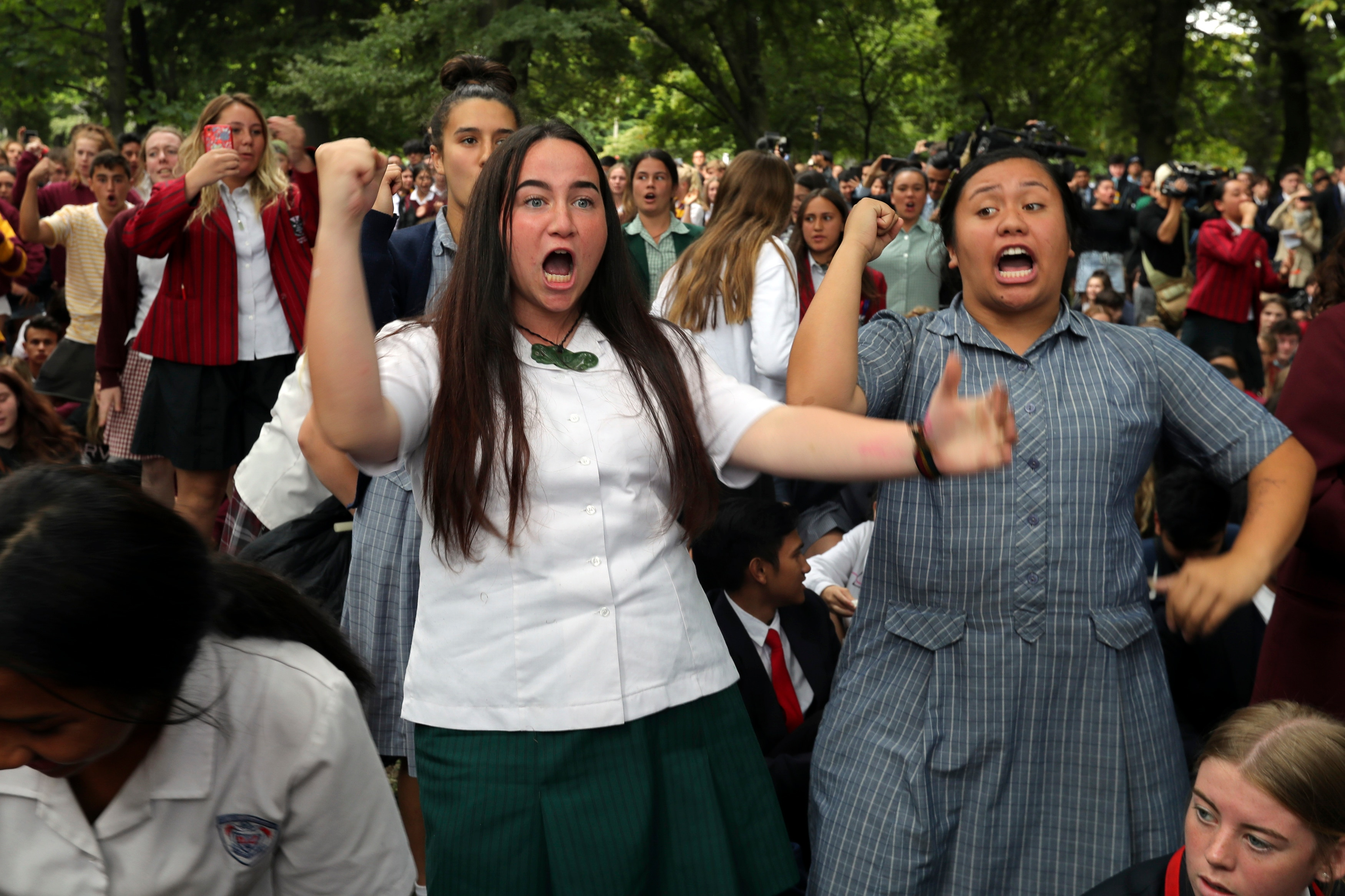 Students perform the Haka during a vigil to commemorate victims of Friday's shooting, outside Masjid Al Noor mosque in Christchurch, New Zealand.