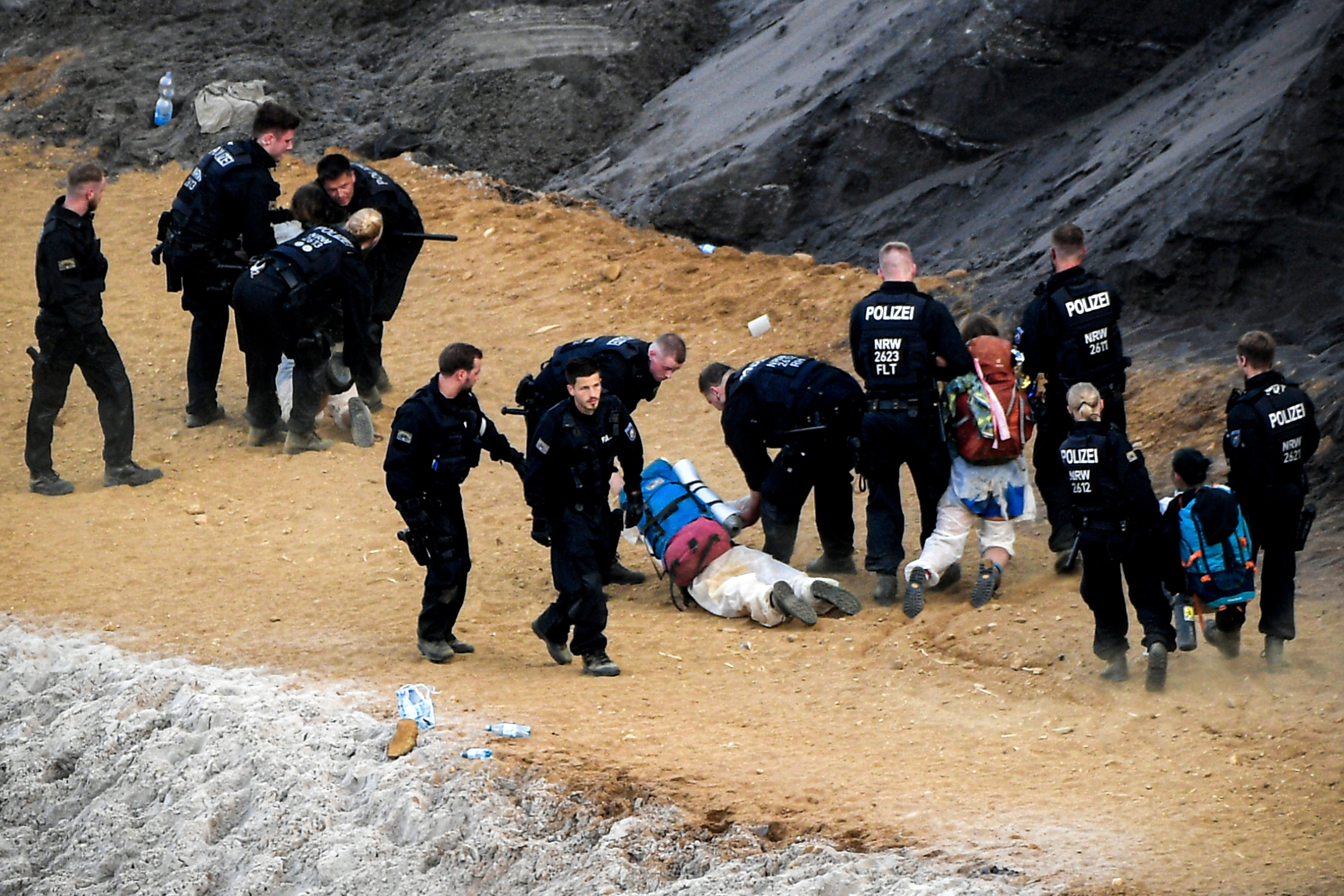 Activists taking part in the 'Ende Gelaende' protest initiative face a police cordon in a pit in the Rhenish coal mining area in western Germany.