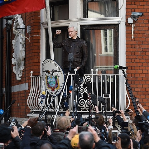 Julian Assange speaks to the media from the balcony of the Ecuadorian Embassy in London, 19 May 2017.