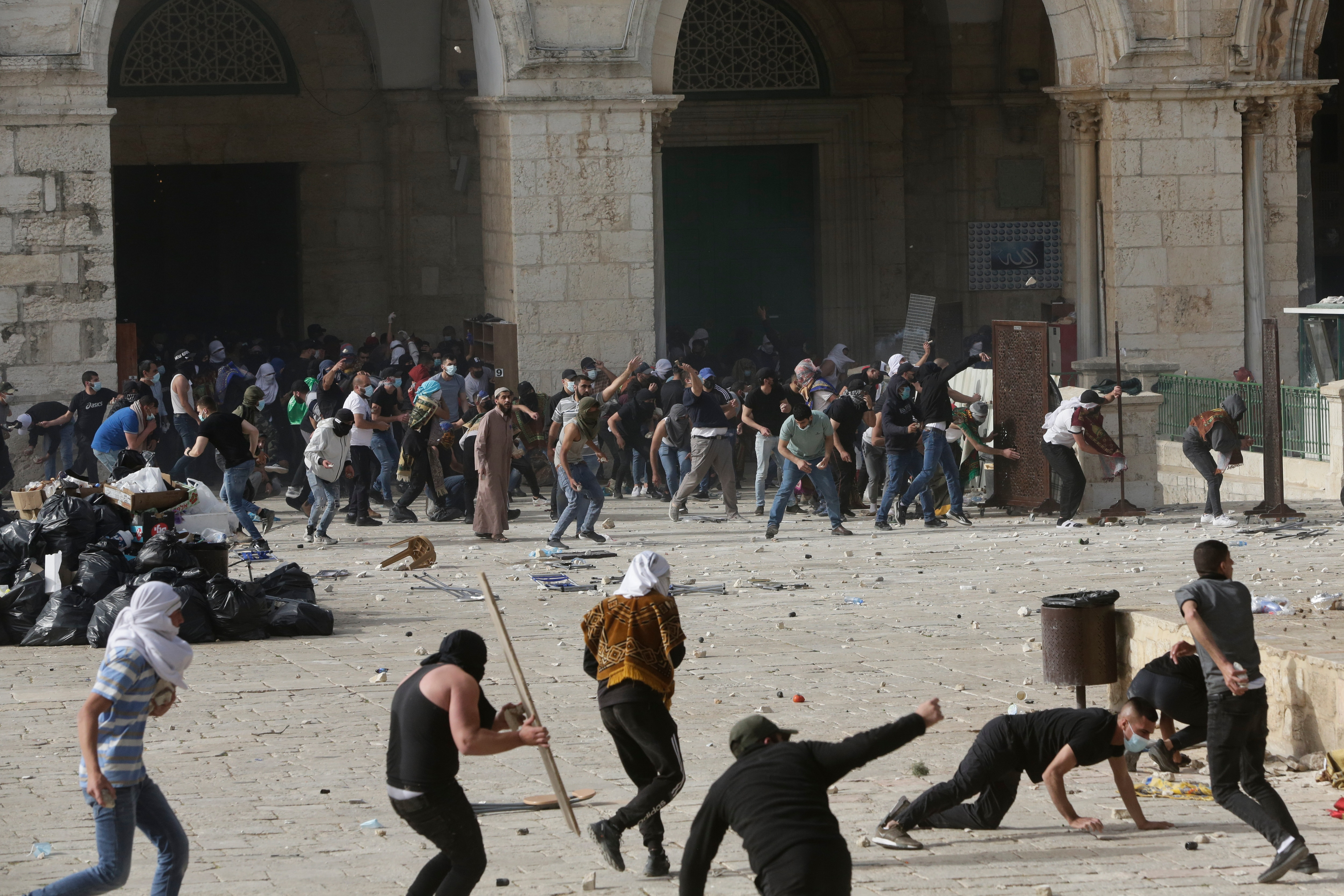 Palestinians clash with Israeli security forces at the Al Aqsa Mosque compound in Jerusalem's Old City Monday, 10 May, 2021.
