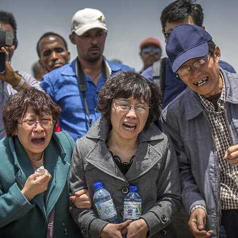 Relatives react at the scene