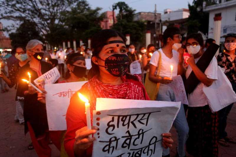 Indian activists protest against an alleged gang rape of a 19 years old Dalit girl in Uttar Pradesh state, in Bhopal, India, 1 October 2020