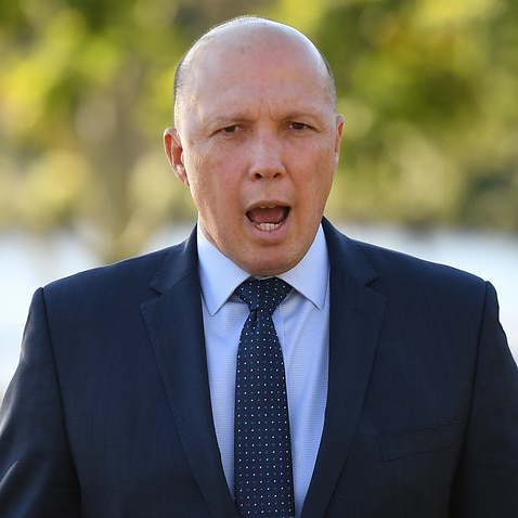 Minister for Home Affairs Peter Dutton speaks to the media in Brisbane, Thursday, May 30, 2019. Mr Dutton was asked about a recent interception of an asylum seeker boat.