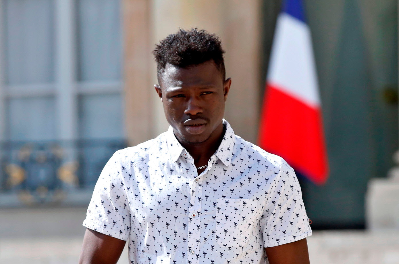 Mamoudou Gassama leaves the presidential Elysee Palace after meeting with the French President in Paris.