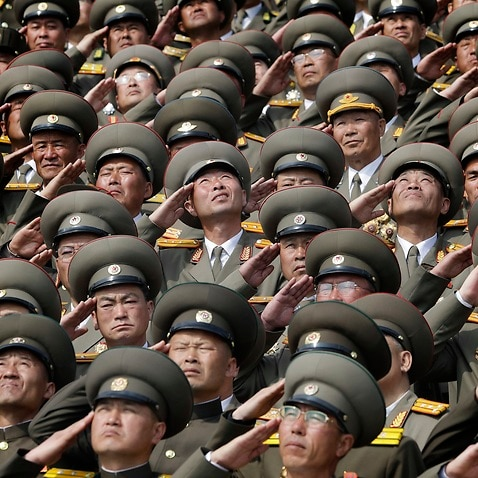 (File Image) Soldiers salute as their national anthem is played during a military parade in Pyongyang.