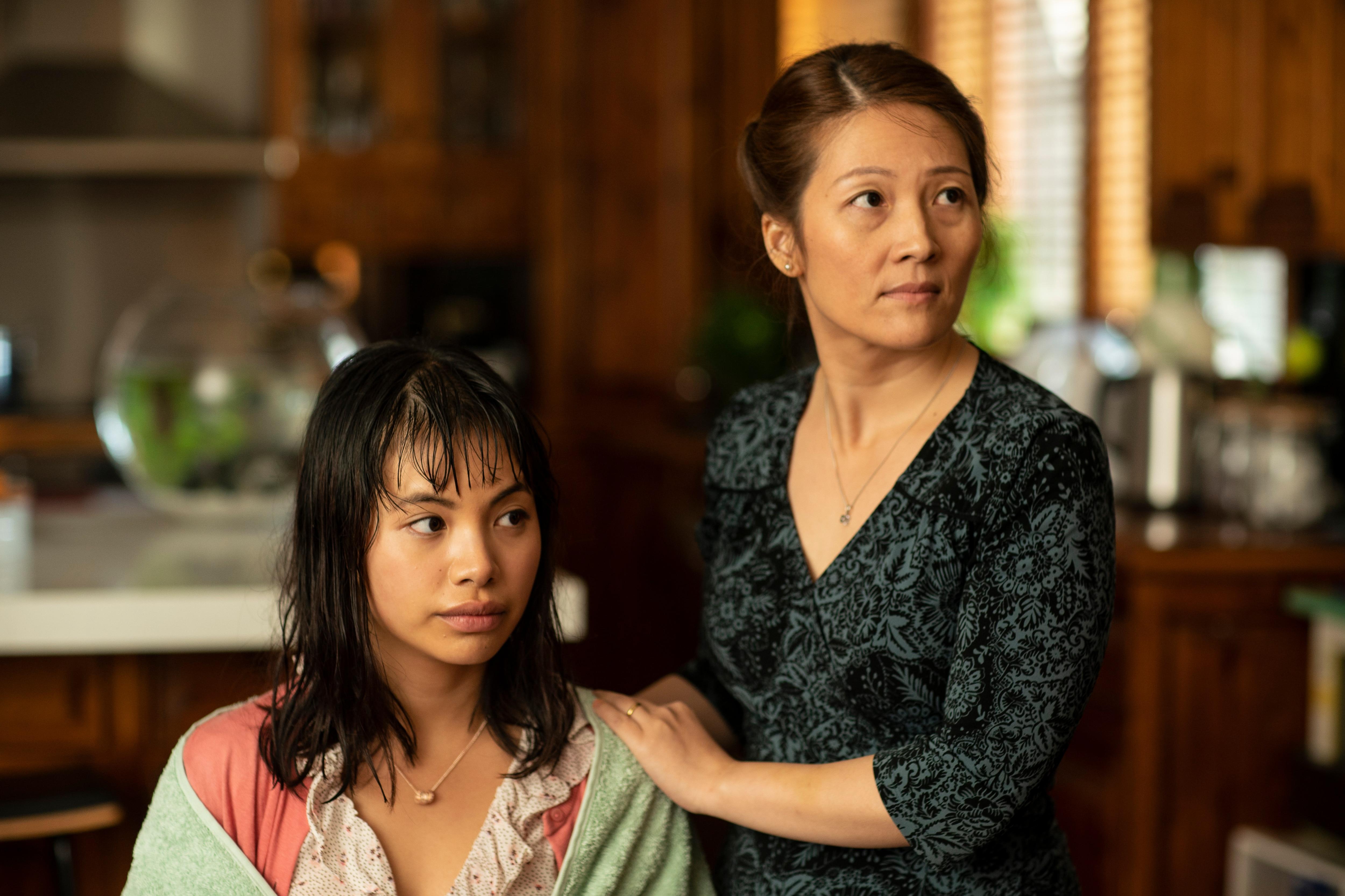 Jillian Nguyen in Hungry Ghosts, alongside her on-screen mother, played by Oakley Kwon.
