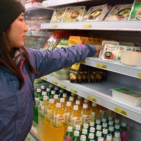 A backpacker shopping at a local supermarket