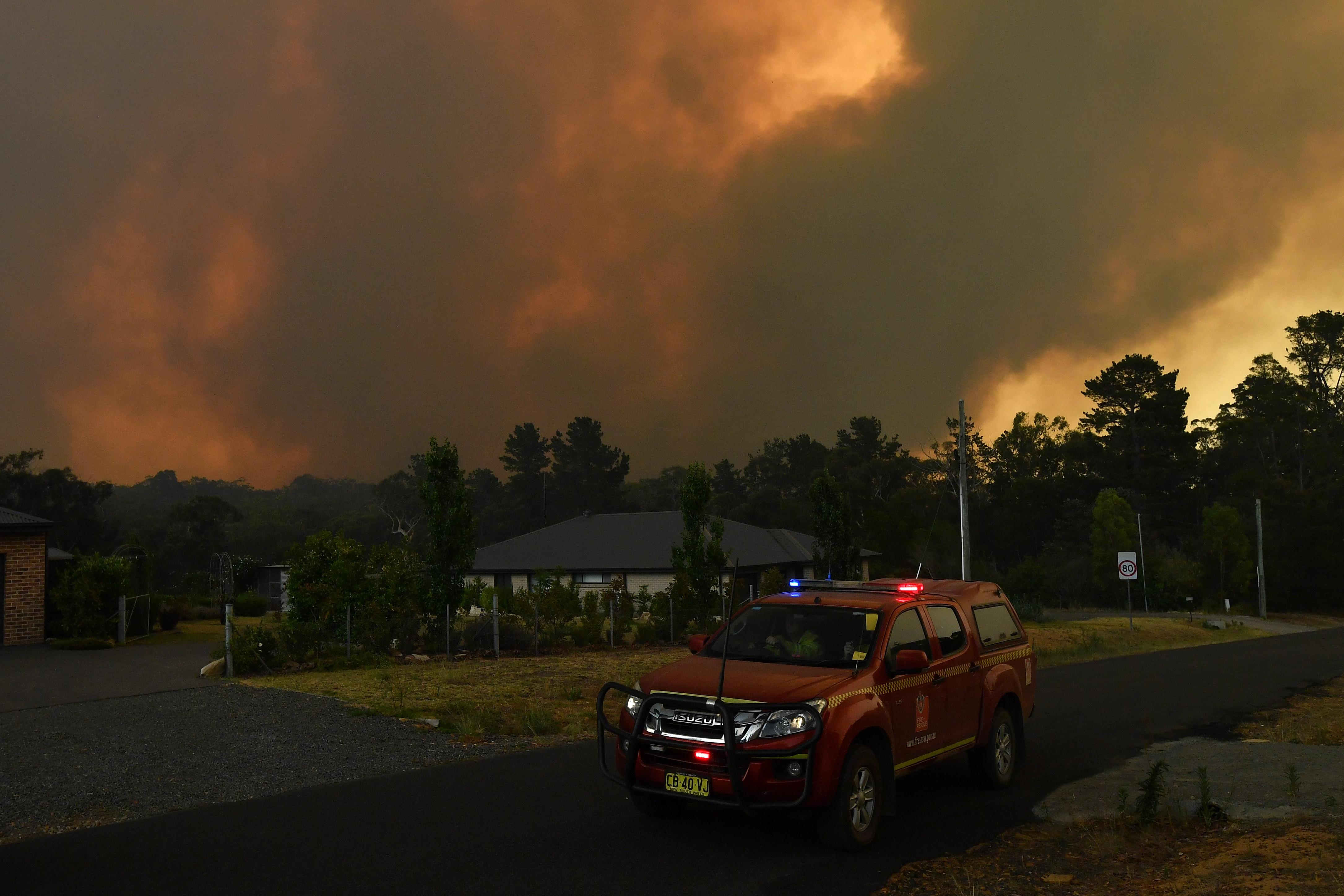 Rural Fire Service (RFS) crews prepare for the Green Wattle Creek Fire as it threatens homes in Yandeera.