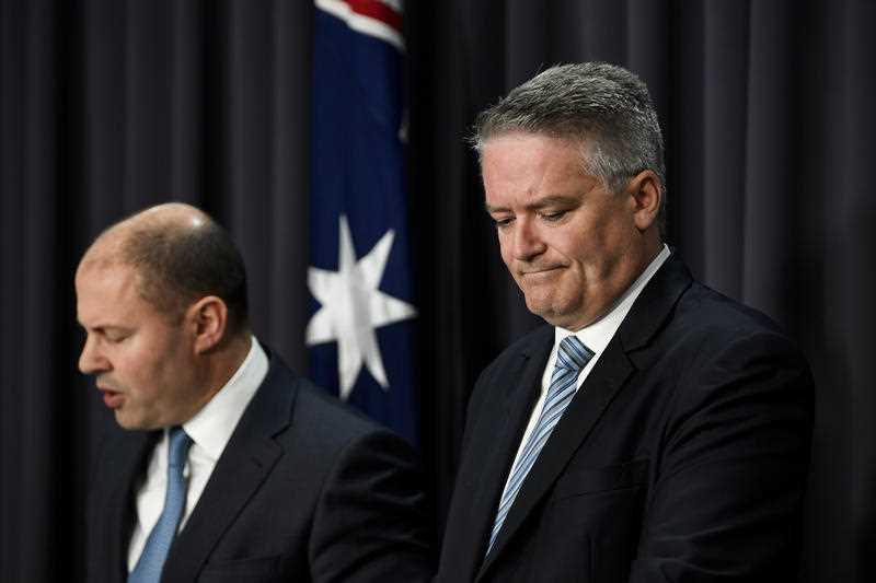Projected Australian budget surpluses slashed by nearly half