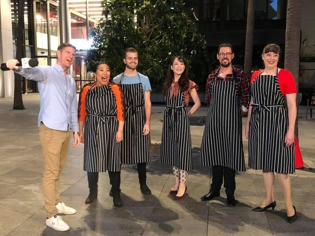 """Ayako Ohtake (Front, third from left), a Sydney-based Japanese soprano singer, will appear on the modern opera titled """"Chop Chef.""""  With other cast and staff."""