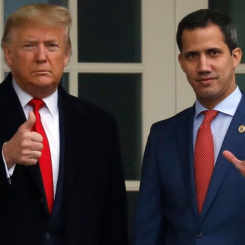 U.S. President Donald Trump thumbs up as he welcomes Venezuelan National Assembly President and opposition leader Juan Guaido before their meeting in the Oval Office of the White House in Washington on February 5, 2020.