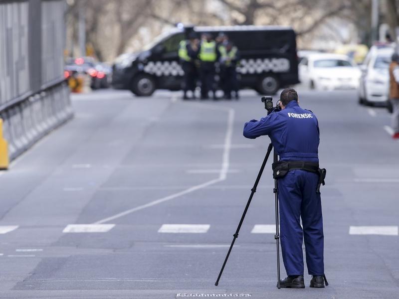 Police investigate a crime scene at Melbourne's EQ Arcade building.